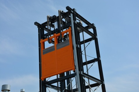 Vertical conveyor - elevator