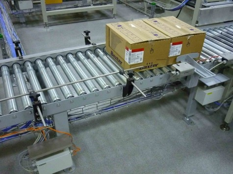 Container and cardboard transport line